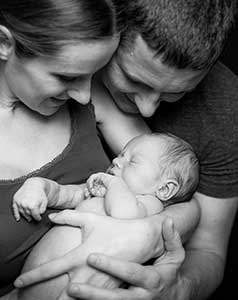 couple holding new born baby ivf