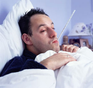 man sick in bed with cold and flu