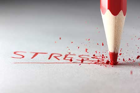 red pencil writing the word stress